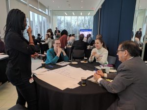 Folks participating in a group exercise at our program preview event on April 26