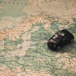 Mini toy car on a map